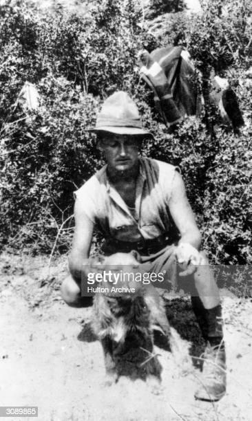 New Zealander soldier W J Batt with a regimental mascot at Walker's Ridge during the Gallipoli campaign in Turkey