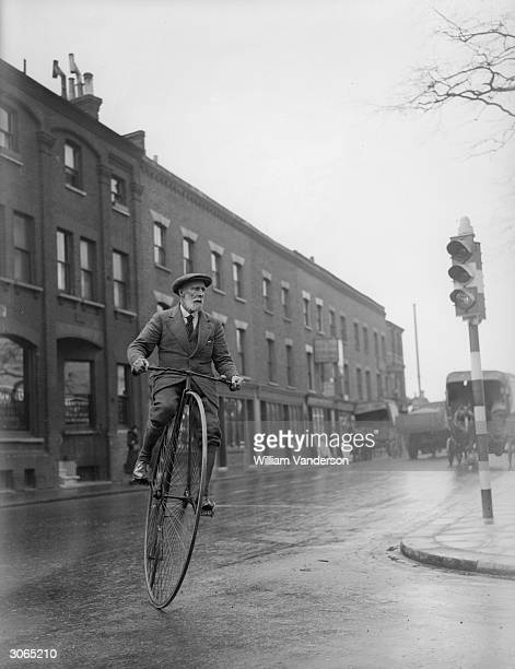 70 year old Mark Hill riding his 45 year old pennyfarthing bicycle in Battersea London