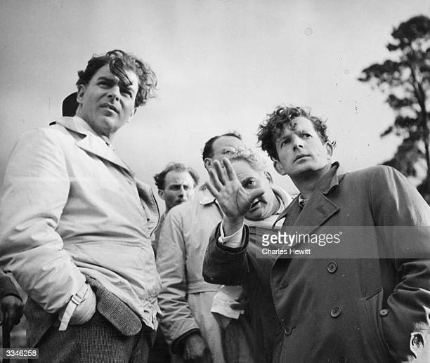 Welsh film director and actor Emlyn Williams left discussing a scene with codirector Russell Lloyd during the filming of 'The Last Days Of Dolwyn'...