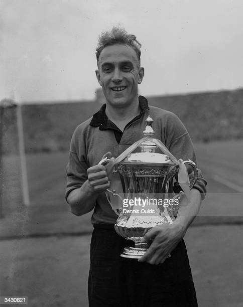 Wolverhampton Wanderers and England captain Billy Wright with the FA Cup