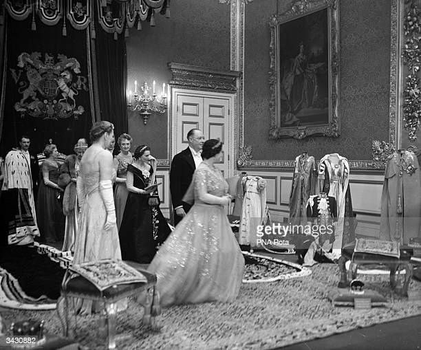 The Queen and the Duchess of Gloucester looking at the Coronation robes in the Throne Room of Saint Jame's Palace London