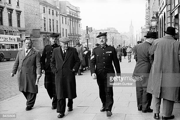 Passersby in an Aberdeen street Aberdeen situated on the North Sea is known as the Granite City because granite is one of its main exports and many...