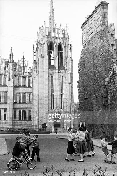 Youngsters playing near a church in Aberdeen Aberdeen situated on the North Sea is known as the Granite City because granite is one of its main...
