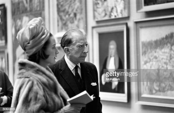 American oil executive multimillionaire and art collector J Paul Getty attends a private viewing of the Royal Academy Summer Exhibition in London...