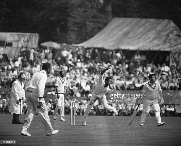 Captain of the West Indies cricket team, Gary Sobers bowling at a match in Arundel.