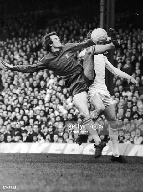 Chelsea full back Eddie McCreadie leaps for the ball during a tussle with Leeds inside forward Alan Clarke, in the FA Cup Final replay at Old...