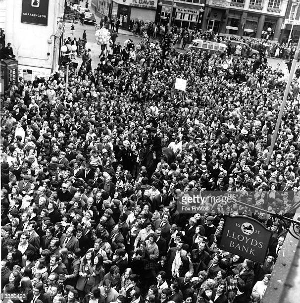 Crowds of football fans line the streets of London to witness the triumphant return of Chelsea Football Club after their 21 victory over Leeds United...