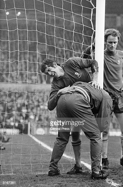 The Chelsea FC and England goalkeeper Peter 'The Cat' Bonetti receiving treatment from trainer Harry Medhurst after clashing with Leeds forward Mick...