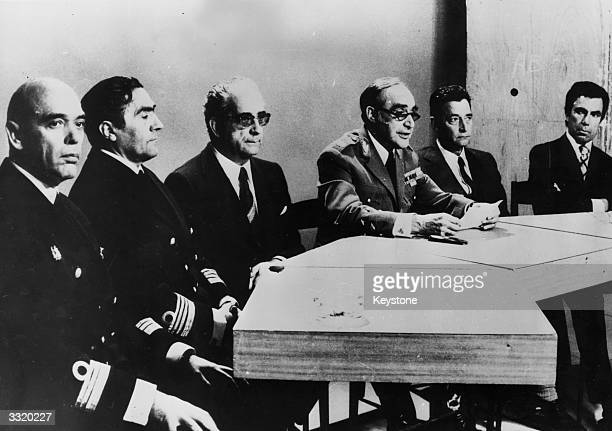 General Antonio Spinola centre chairs a press conference at Lisbon with officers of the junta after overthrowing the Caetano government At the table...