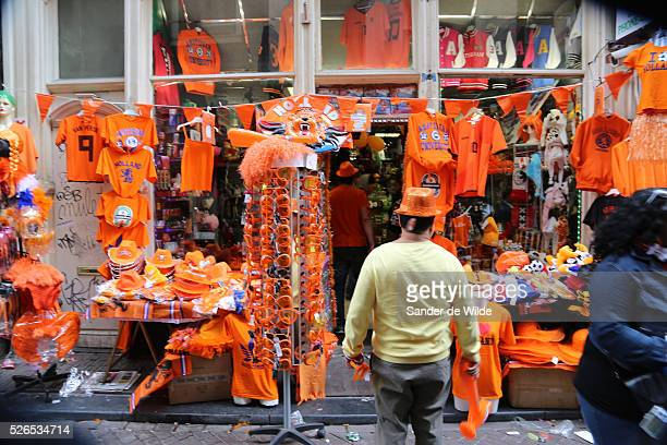 30th April 2013 Amsterdam Netherlands Queen Beatrix' abdication day where her son Prince WillemAlexander became King of the Netherlands A man looks...