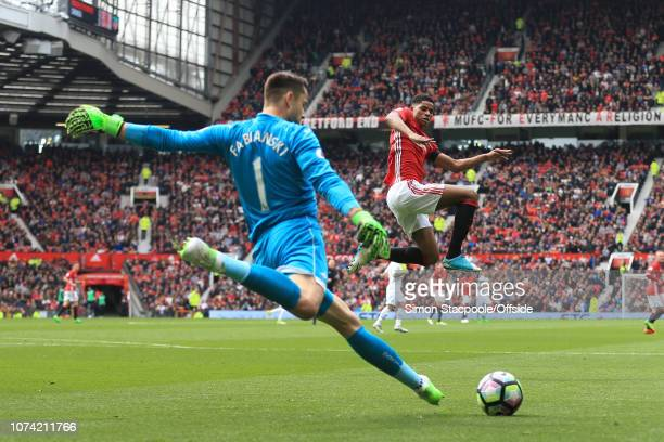 30th April 2017 - Premier League - Manchester United v Swansea City - Marcus Rashford of Man Utd jumps to block a clearance from Swansea goalkeeper...