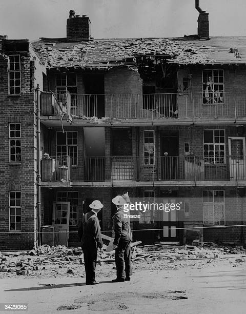 Damaged flats in the London area of Hornsey being inspected following an air raid in WW II