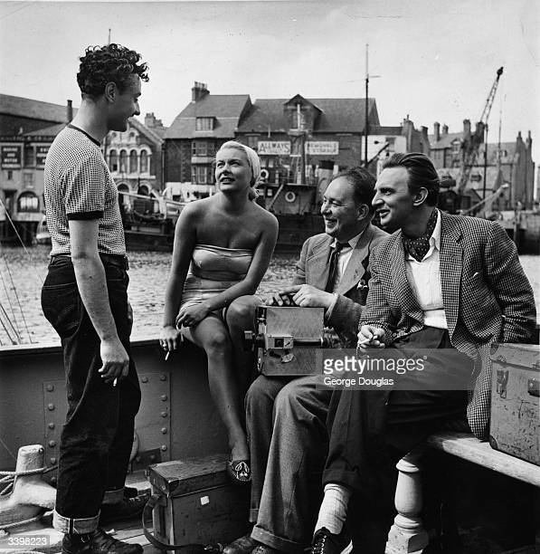 American film actress Barbara Payton chats to Michael Carreras producer of a British film 'The Four Sided Triangle' being shot at Weymouth in Dorset...
