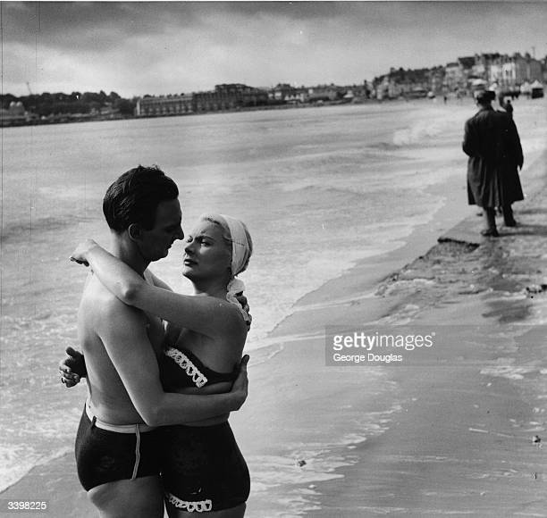 American film actress Barbara Payton in an embrace with her leading man Stephen Murray for a scene in a British film 'The Four Sided Triangle' being...
