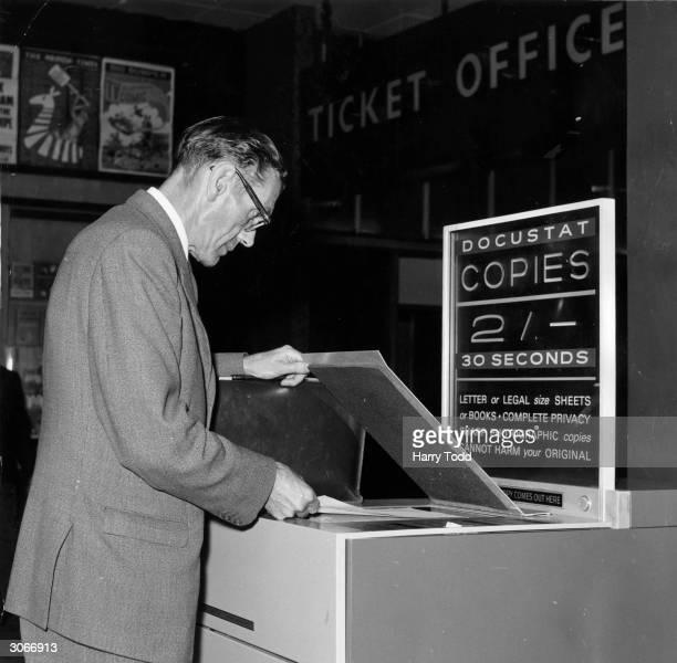 Mr R H Ratcliffe makes a photocopy of a document at Paddington Station, London, on a public photostat machine.