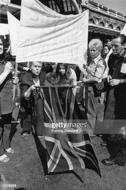A racist demonstration at Smithfield London Their banner reads 'Stop The Asian Invasion'