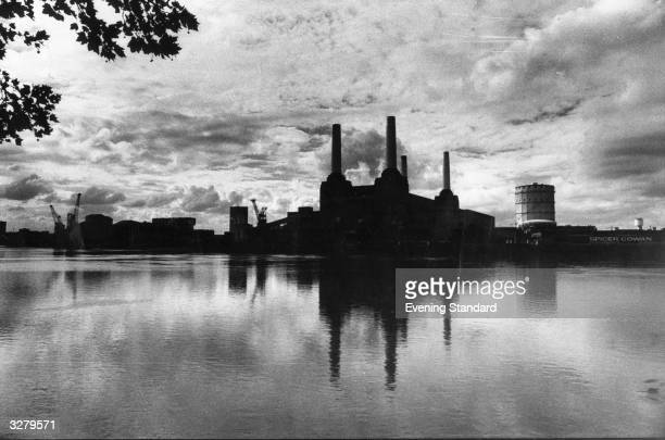 The gothicstyle towers of Battersea Power Station designed by leading architect Giles Scott on the bank of the river Thames