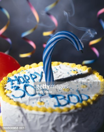 30th Birthday Cake With Single Curved Candle Stock Foto