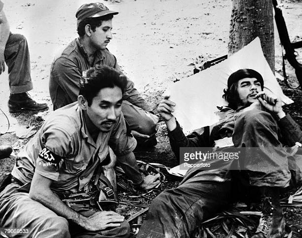 30th December 1958 Argentine politician and soldier Ernesto Che Guevera relaxes with other members of fidel Castros rebel army after capturing the...