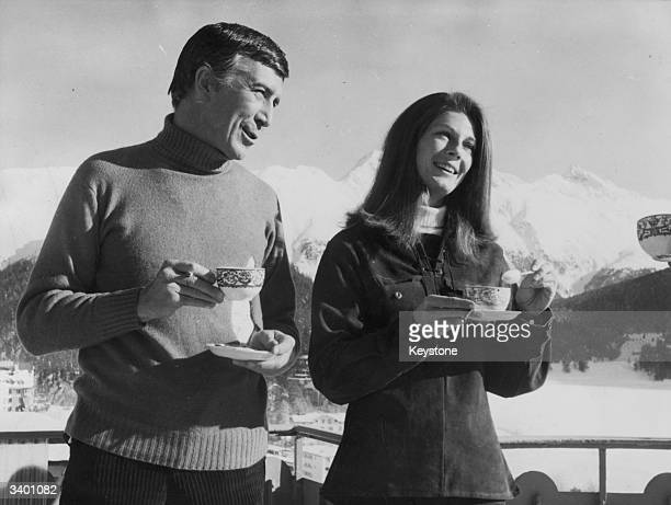 American film actor Patrick O'Neal and Baroness Fiona Thyssen take some tea on a balcony of the Palace Hotel, St Moritz during the filming of...