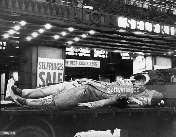 Statues which decorated Selfridges department store in London's Oxfod Street over the Christmas period being thrown away now the festivities are over.