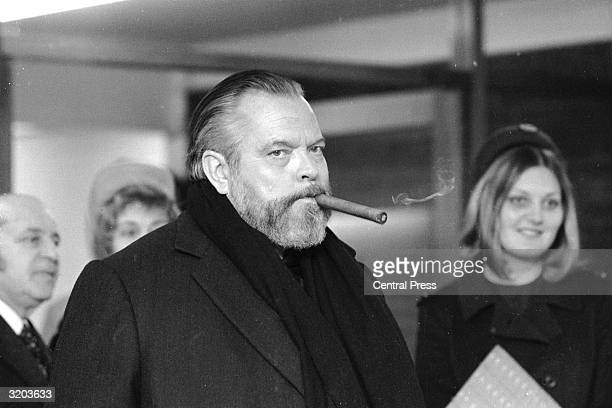 American actordirector Orson Welles at Heathrow Airport during shooting of 'Future Shock' an environmental film for US TV
