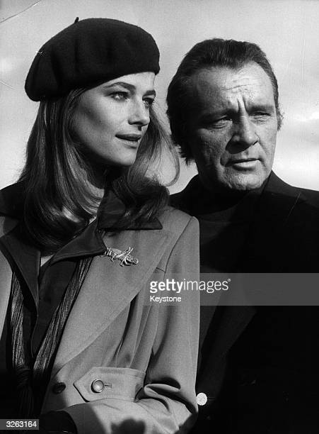 British actress Charlotte Rampling with Richard Burton at Nice Airport during filiming of the movie 'Jackpot'