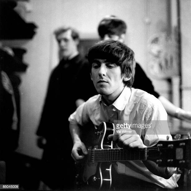 George Harrison from The Beatles posed backstage at the Finsbury Park Astoria London during the band's Christmas Show residency on 30th December 1963