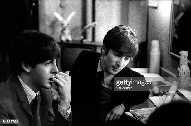 30th DECEMBER: Paul McCartney and John Lennon from The Beatles posed backstage at the Finsbury Park Astoria, London during the band's Christmas Show...