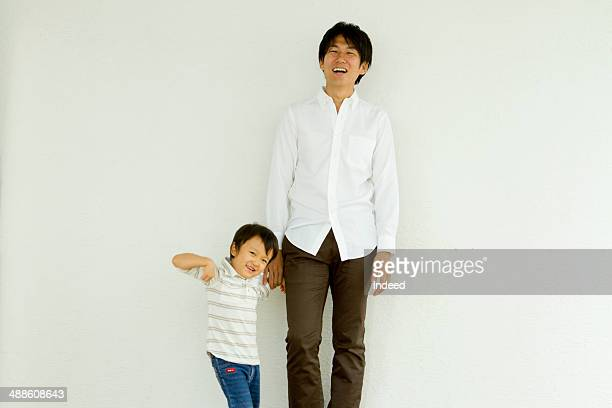 30th generation man and his child who make pose