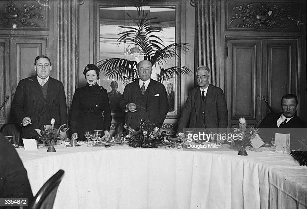 Guests at a lunch held at the Carlton Hotel London prior to the premiere of the Cecil B DeMille film 'The Sign of the Cross' From left to right they...