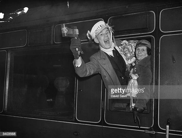 Manchester United FC supporters arrive at Euston Station London en route to Highbury where their team meet Arsenal FC in an FA Cup match
