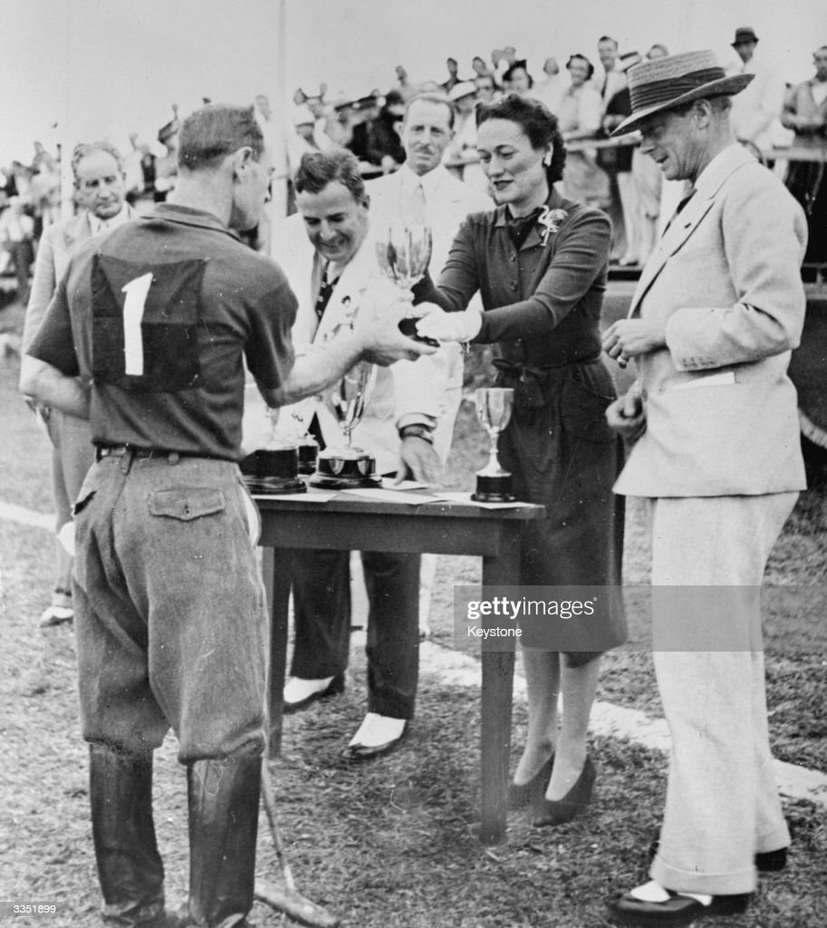The Duchess of Windsor (1896 - 1986) presents a trophy to Ted Pyfrom of the Blackhawks polo team in Nassau, Bahamas. The Duke of Windsor (1894 - 1972) who was Governor of the Bahams during WW II watches.