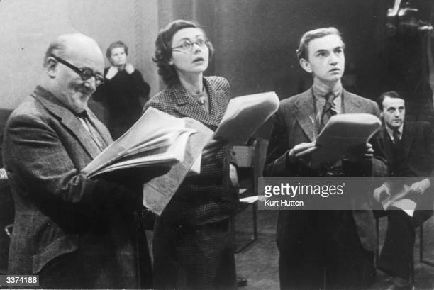 British actors Frederick Lloyd Celia Johnson and Peter MillerStreet reading from a script during a BBC radio broadcast of Tolstoy's 'War and Peace'...