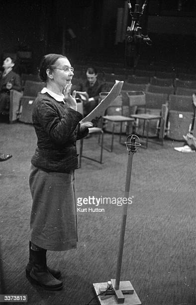 Russian born ballerina and wife of the economist John Maynard Keynes, Lydia Lopokova reading from a script during a BBC radio recording of Tolstoy's...
