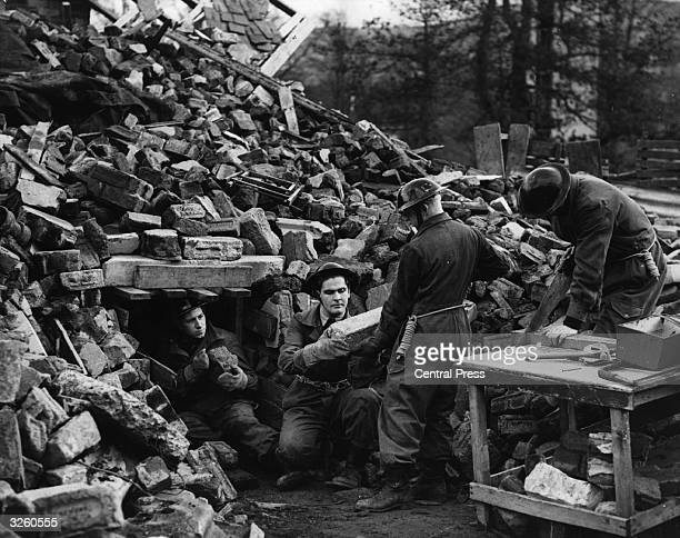 Team of National Service Volunteers in training for Civil Defence measures at Taymouth Castle near Aberfeldy, Perthshire, building a tunnel through...