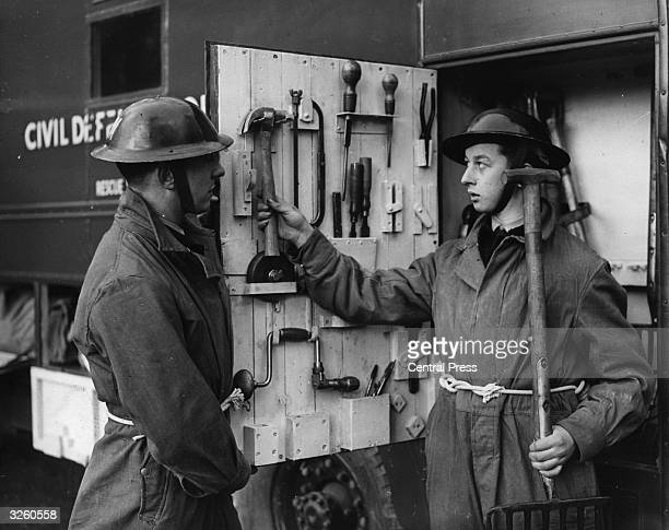 Two National Service Volunteers at a Civil Defence training centre at Taymouth Castle near Aberfeldy in Perthshire, with tools stored in the...
