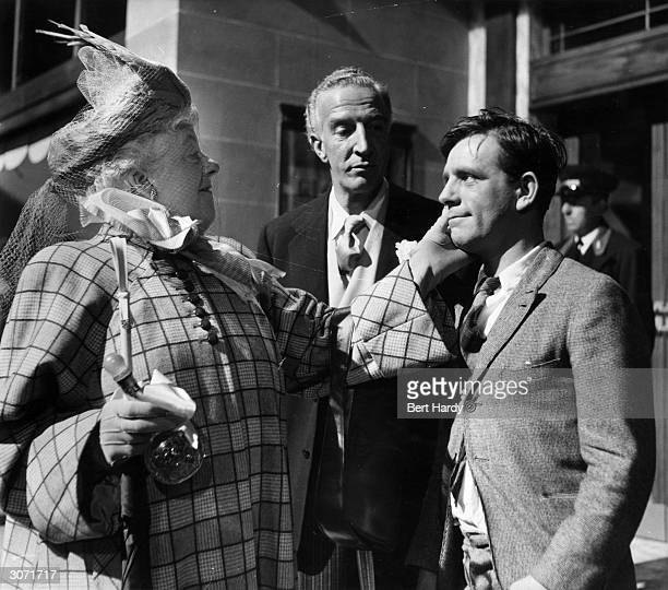 British comedian Norman Wisdom in a scene from his debut film 'Trouble In Store', directed by John Paddy Carstairs, with British character actress...