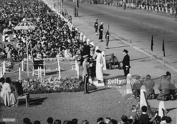 India celebrating its republic day with a five mile long parade starting at the Great Place and ending at the historic Red Fort The president...