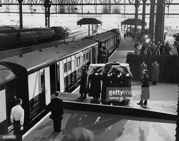 Coffin of Sir Winston Churchill covered with the Union Jack is carried on to a train at Waterloo station London for the journey to Bladon for burial