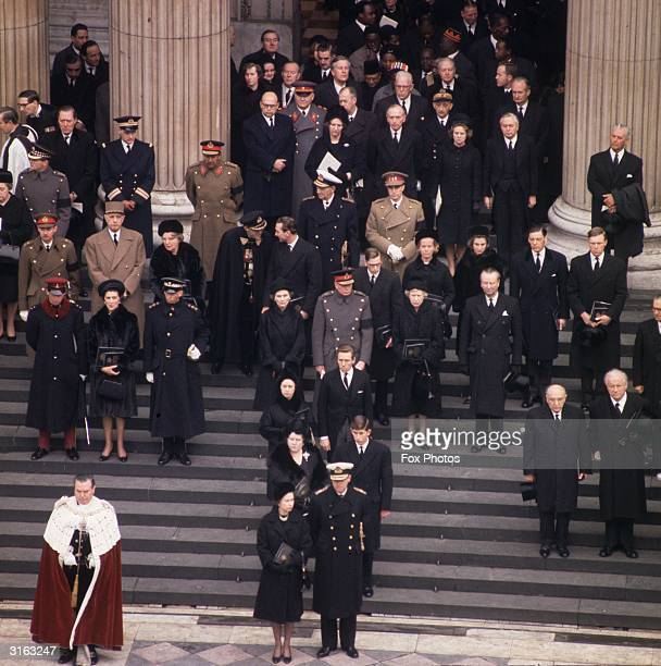Mourners at the funeral of Sir Winston Churchill on the steps of St Paul's Queen Elizabeth II and Prince Philip are in the front behind them the...