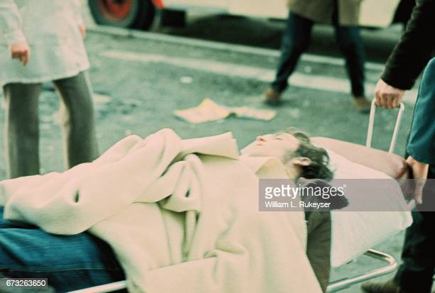 30th January 1972 A civilian shot and wounded after British paratroopers opened fire on civil rights marchers is wheeled to an ambulance from outside...