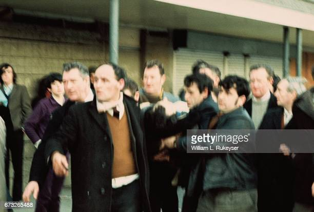 30th January 1972 A civilian shot and wounded by British paratroopers is rushed to a waiting ambulance Soldiers opened fire on the civil rights march...