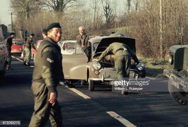 30th January 1972 A motorist looks unconcerned as British soldiers search his car at a roadblock on the BelfastLondonderry road on the day of a civil...