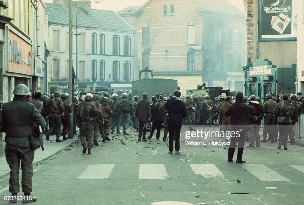 30th January 1972 British soldiers and members of the press are pictured behind armoured water cannon and armoured cars as tensions rise during a...