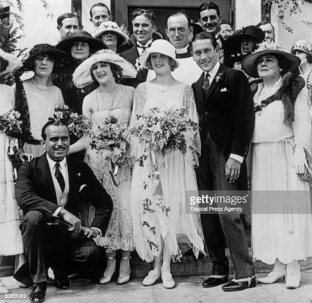 The wedding of actress Marilyn Miller to Jack Pickford Guests include the American actor Douglas Fairbanks 1883 1939 kneels at left Mary Pickford the...