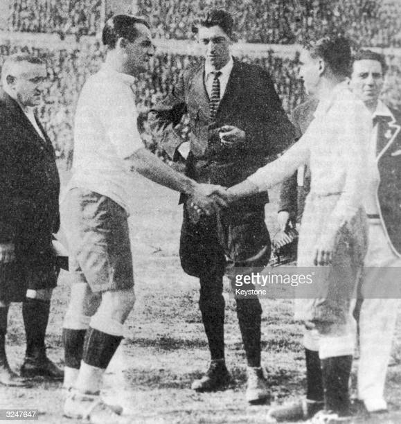 Uruguayan captain Jose Nazassi shakes hands with his Argentinian counterpart 'Nolo' Fereyra before the final of the first world Cup competition in...