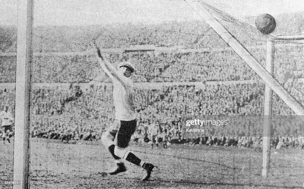 Uruguayan keeper Enrique Ballestrero fails to save a shot from Argentina's Carlos Peucelle to equalising the score at 2-2 in the final of the first world Cup competition in Montevideo, Uruguay. Uruguay eventually won 4-2.