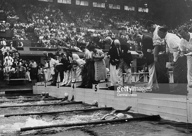 The finish of heat three in the Olympic Women's 100 Metres Free Style race at the Empire Pool Wembley The winner was E Ahlgreen of Sweden with KM...