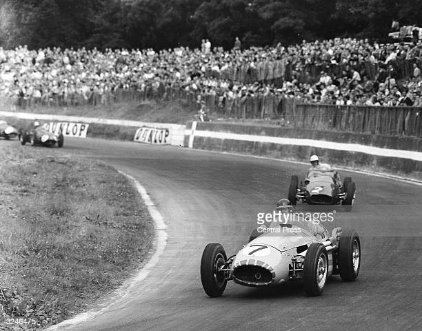 Mike Hawthorn on his way to winning the International Trophy Race at Crystal Palace in Stirling Moss' Maserati.